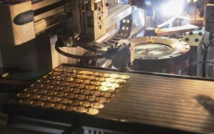 how gold coins are made by a coin press
