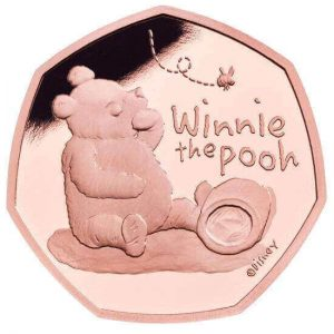 E. H. Shepard's original design on the reverse of these collectible 22 karat Winnie the Pooh gold coins